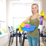 Image Lady holding houshold cleaning supplies